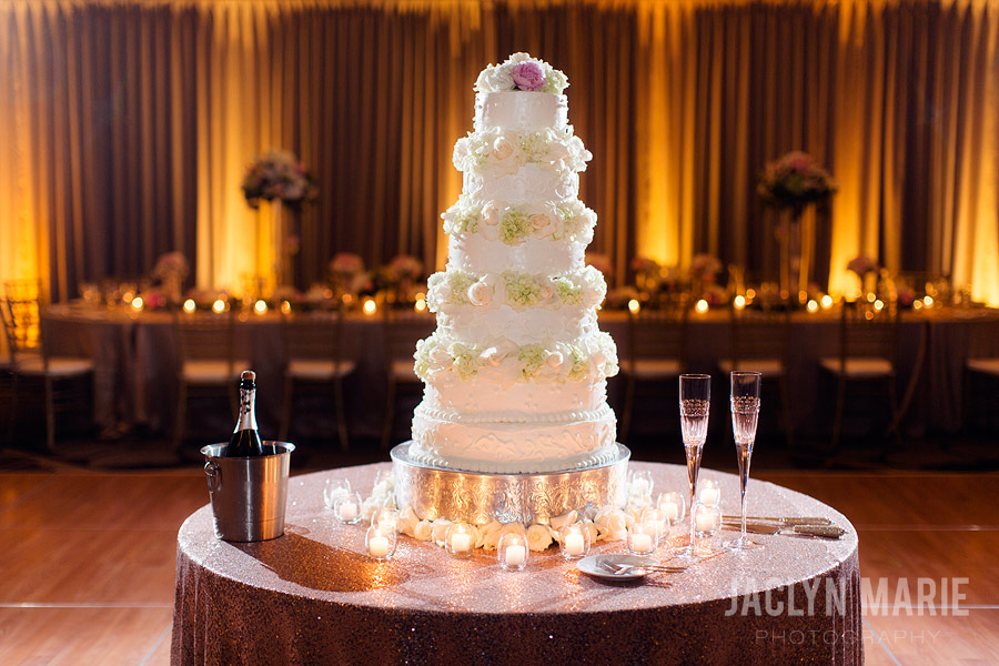Tall wedding cake with flowers photo